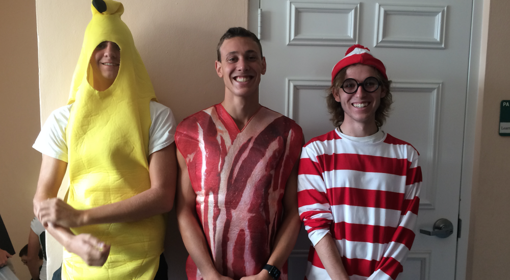 Seniors Noah Sprosty (left), Ryan Graff (middle), and Matthew Merrigan (right) show their holiday spirit by dressing as a banana, a piece of bacon, and
