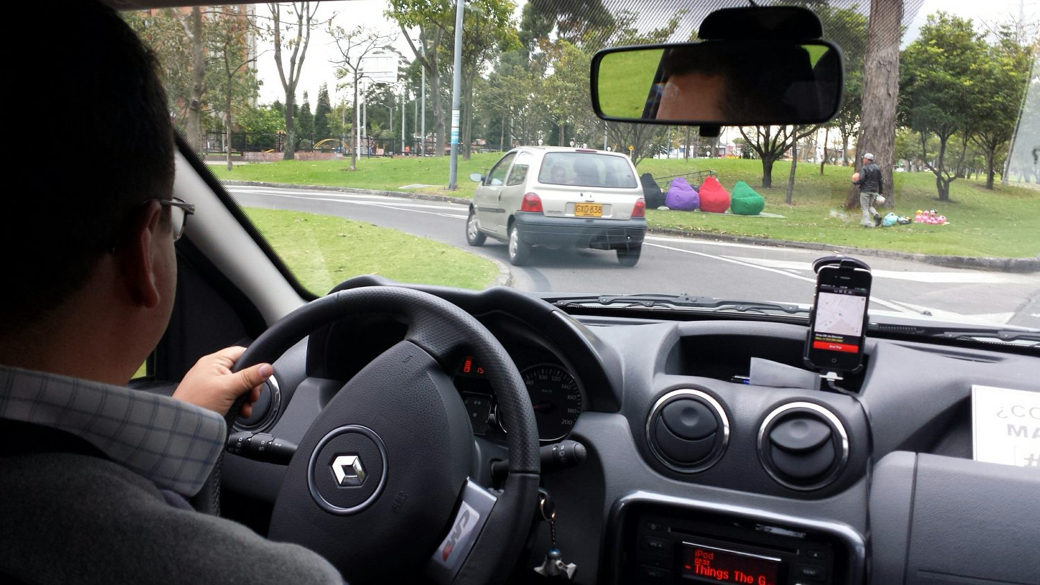 A classic Uber drive, with the Uber app visible on the phone.