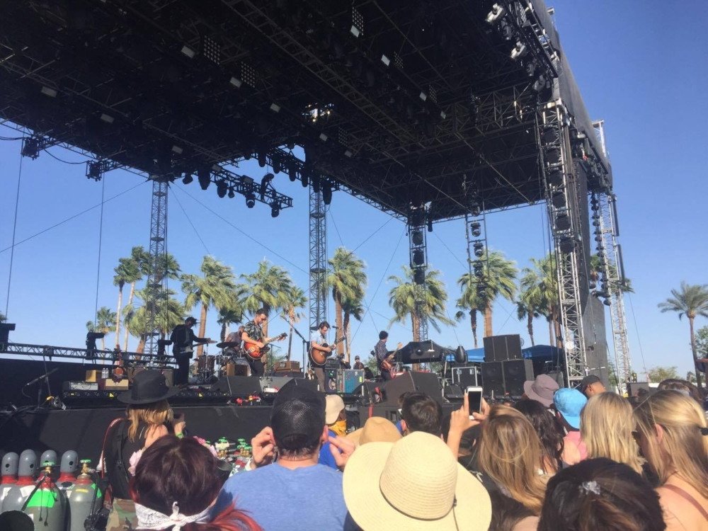 The audience is raptly watching the performers onstage at Coachella (via, Megan Eisenfelder, senior).