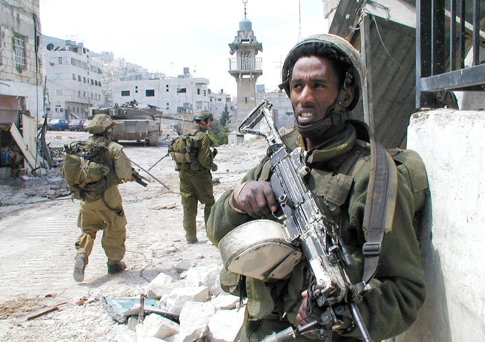 IDF officers stand guard in the city of Nablus, Israel.  The IDF has created a culture of hatred and prejudice toward the Palestinians. (Israel Defense Forces via Wikimedia Commons)