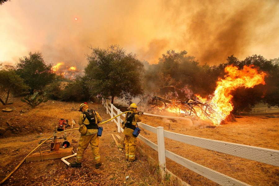 Northern California firemen continue to work to put out the raging fire. (via Daria Devyatkina)