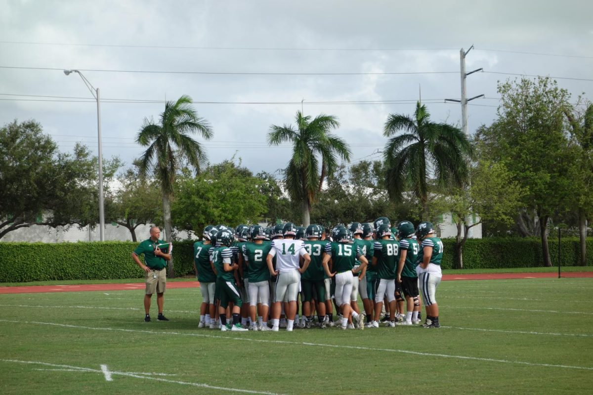 The Pine Crest football team, seen here in the huddle, is ready for the big homecoming game this week. (Photo via Ana Selden/Junior)