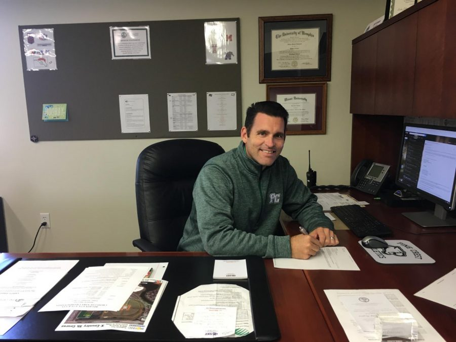 Mr. Johnson busy at work as he organizes athletic events for the year.