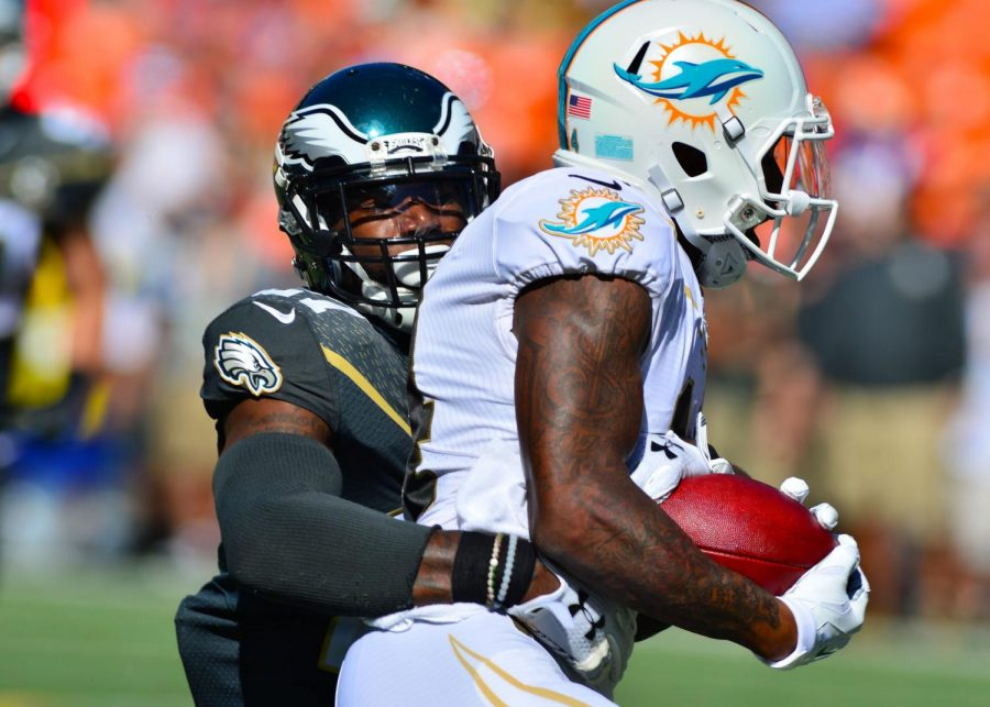 Wide receiver Jarvis Landry being brought down by Eagles' safety Malcolm Jenkins (via Tech. Sgt. Aaron Oelrich)