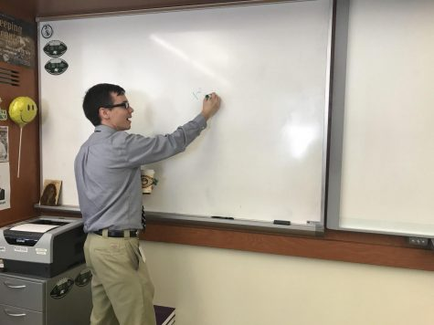 Mr. Lowe hard at work during an important math lesson.