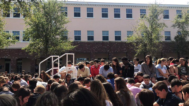 Pine Crest students gathered outside of the Upper School at noon to honor the 17 lives lost in the Douglas tragedy.