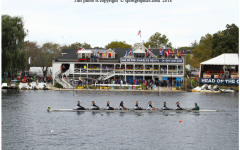 The girls' eight nearing the Elliott Bridge (via Sports Graphics).