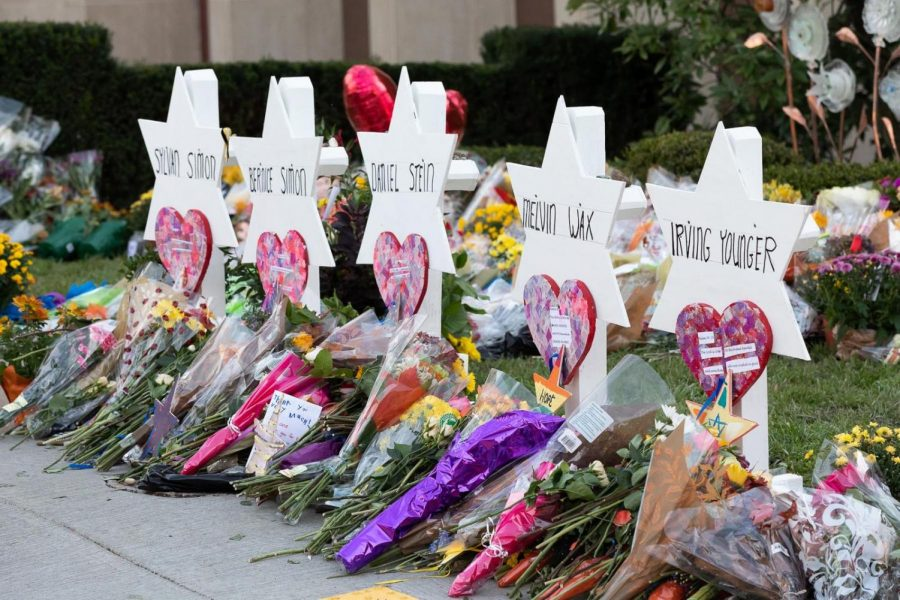 Memorials are set up outside the Tree of Life synagogue in Pittsburgh after the October 27th shooting that killed 11 people (via Andrea Hanks, Wikimedia Commons).