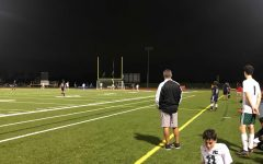 Boys' Varsity Soccer Team working hard at their game on Best Field.