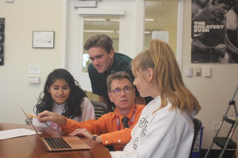 Dr. Stewart, co-founder of the program, works with students.