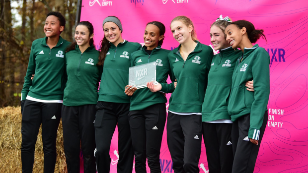Girls%27+Cross+Country+Team+smiling+big+at+NXR+in+Oregon.+